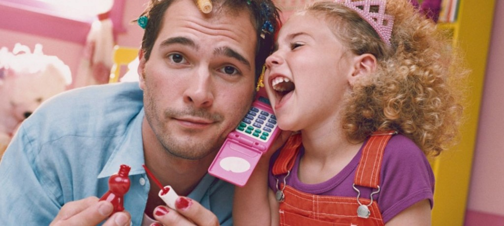 Daughter-playing-with-father-with-hair-curlers-and-nail-polish-1074x483